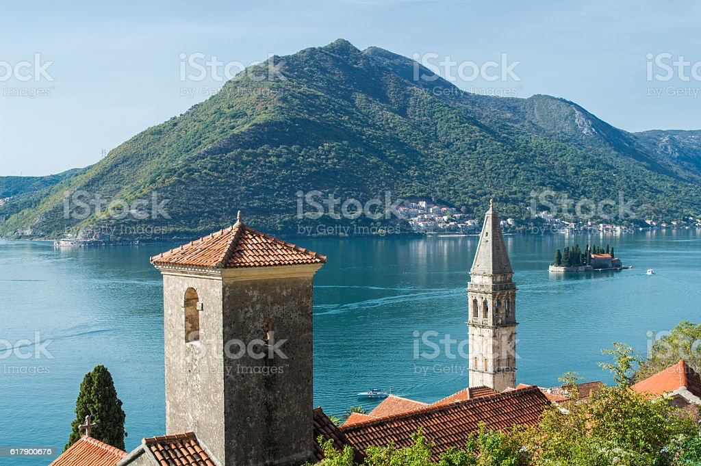 Old town Perast, church and two islands stock photo