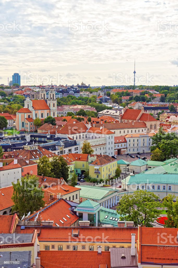 Old town roofs and Church of All Saints of Vilnius stock photo