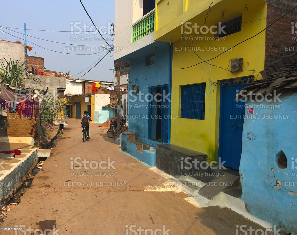 Old town street and a boy, indian town Khajuraho stock photo