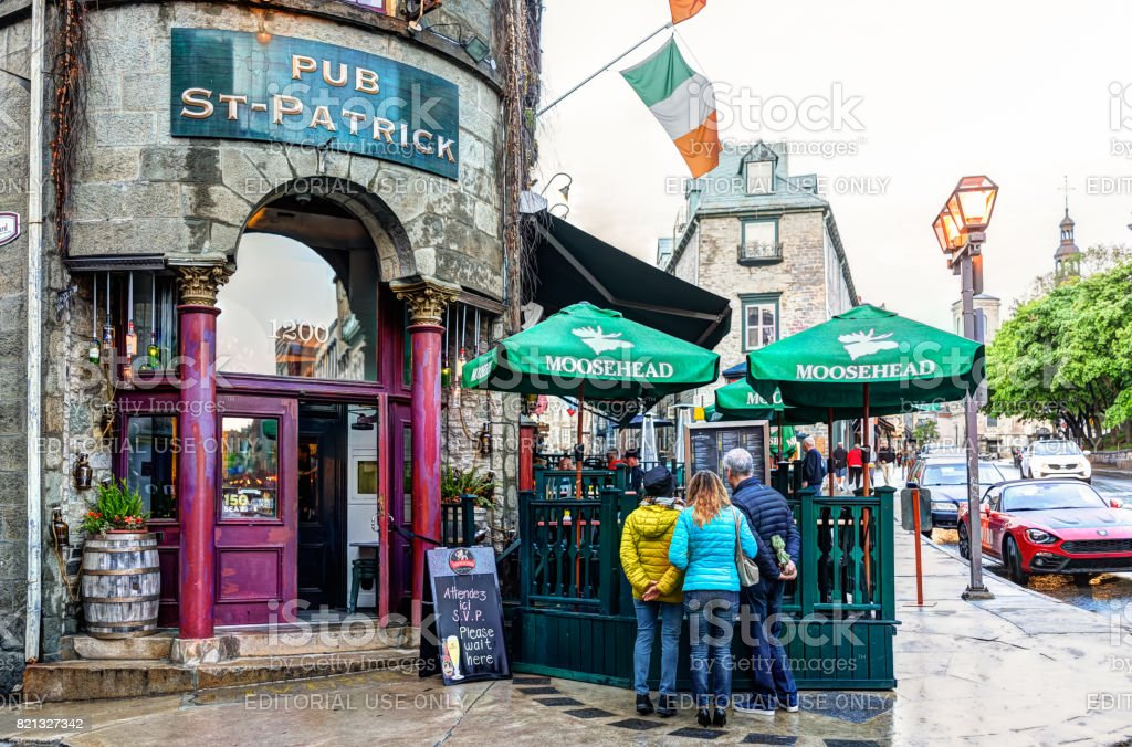 Old town street with Pub St Patrick restaurant entrance bar stock photo