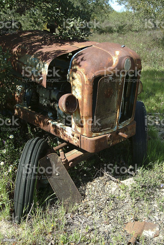 Old tractor in farm royalty-free stock photo