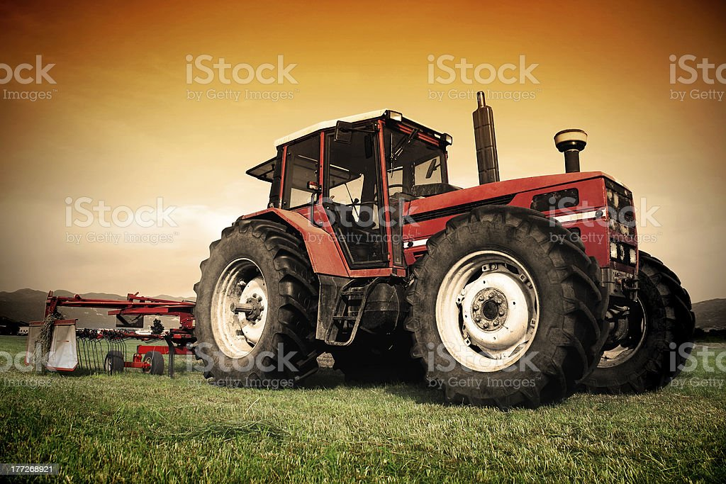 Old tractor on the field stock photo