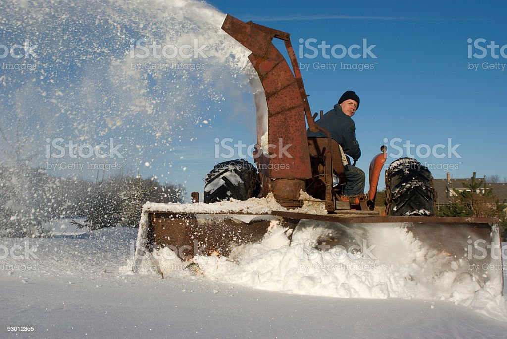 Old Tractor Snowblowing in Winter stock photo