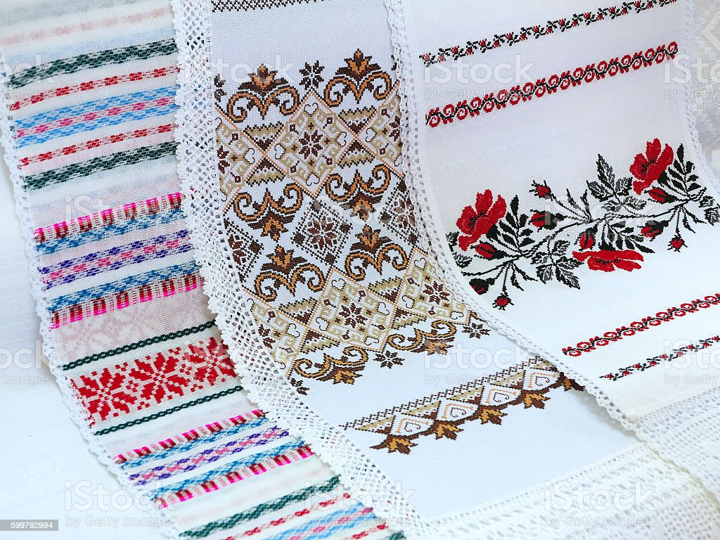 Old traditional balkan handmade floral embroidery on white canva stock photo