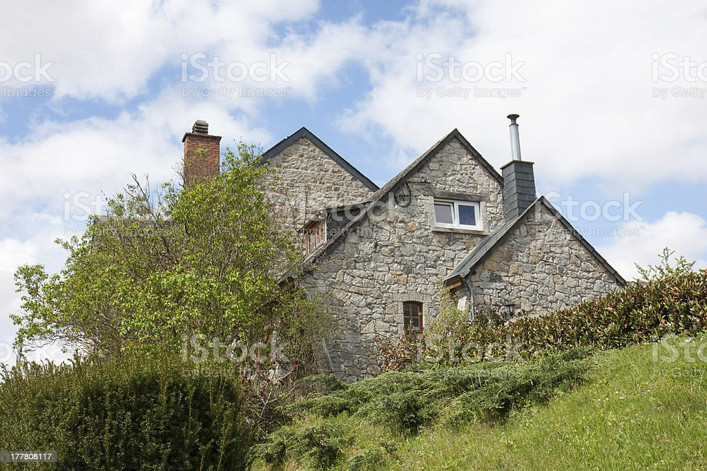 Old traditional house with garden in Belgium royalty-free stock photo