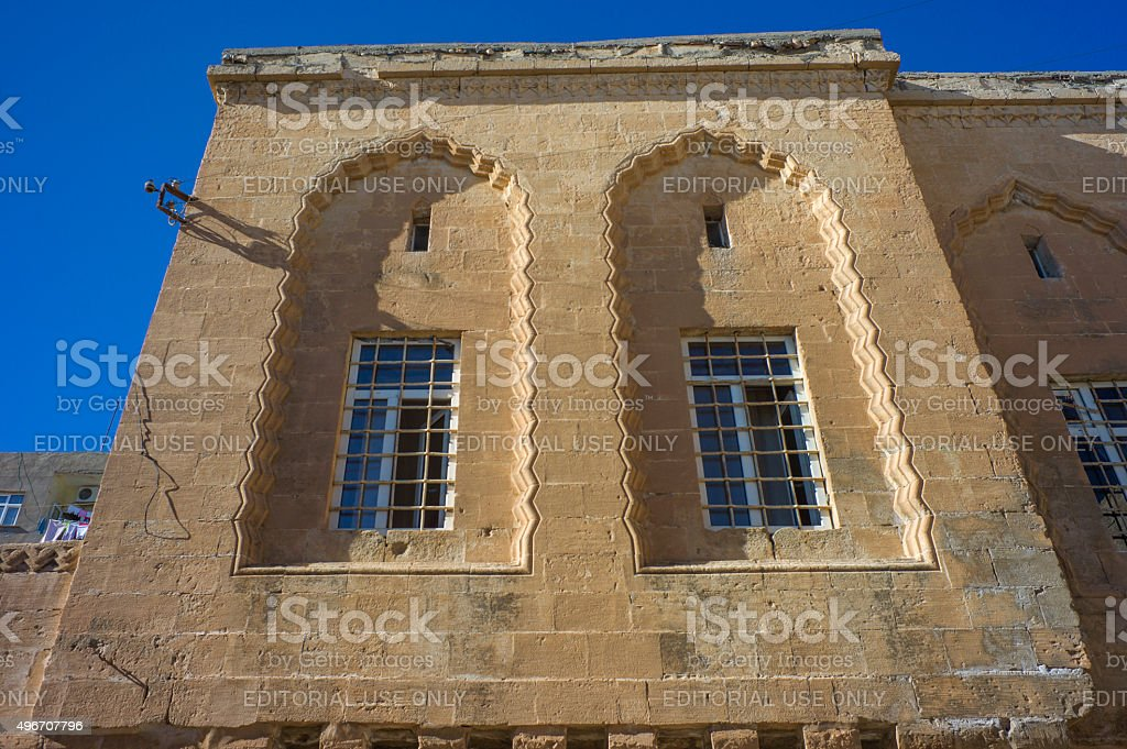 Old traditional stone house windows at middleeastern town mardin turkey stock photo