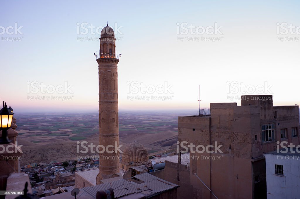 Old traditional stone minaret at  middleeastern town mardin turkey stock photo