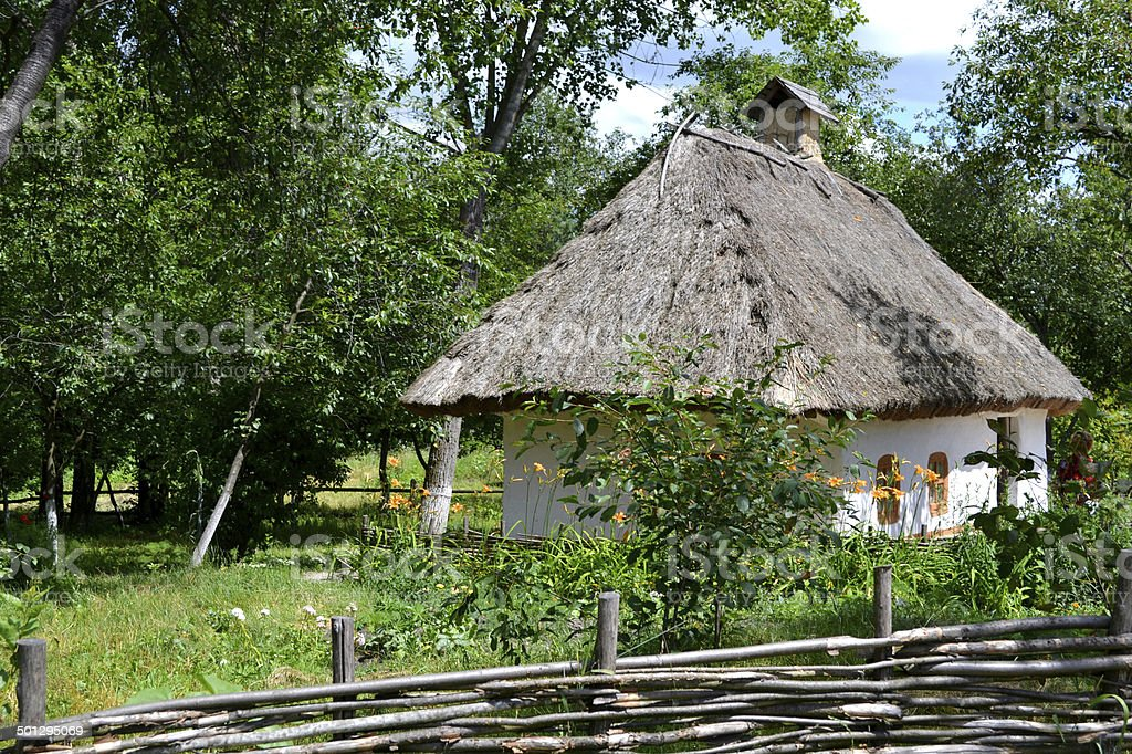 Old traditional Ukrainian house hata made from wood and straw stock photo