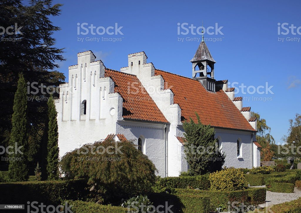 Old traditional village church at a graveyard stock photo
