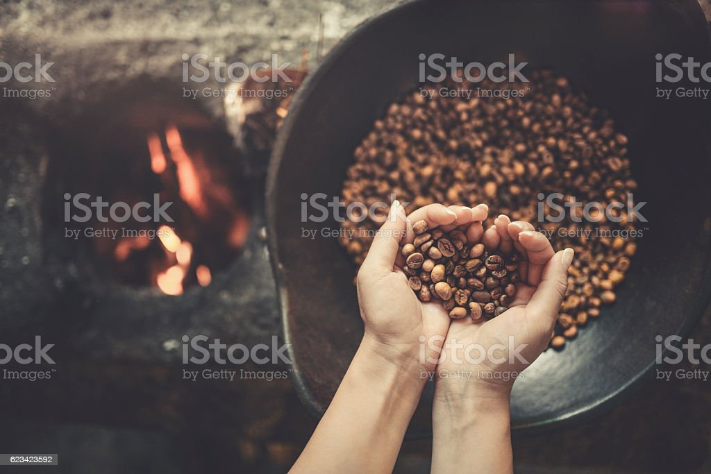 Old Traditional Way of Roasting Raw Coffee Beans on Fire stock photo