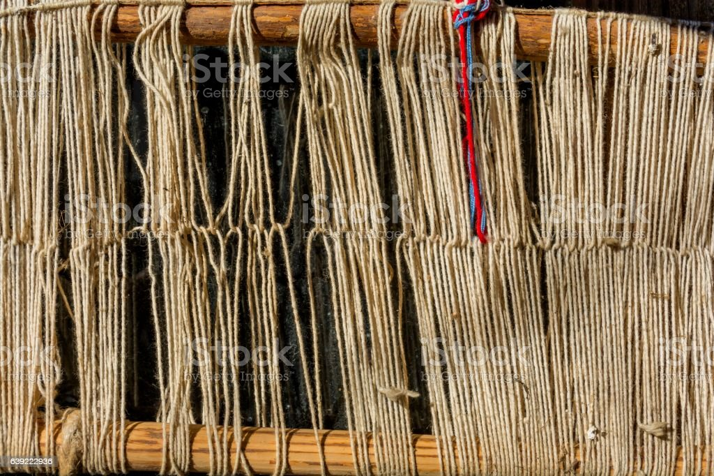 Old traditional weaving loom and shuttle on the warp. stock photo