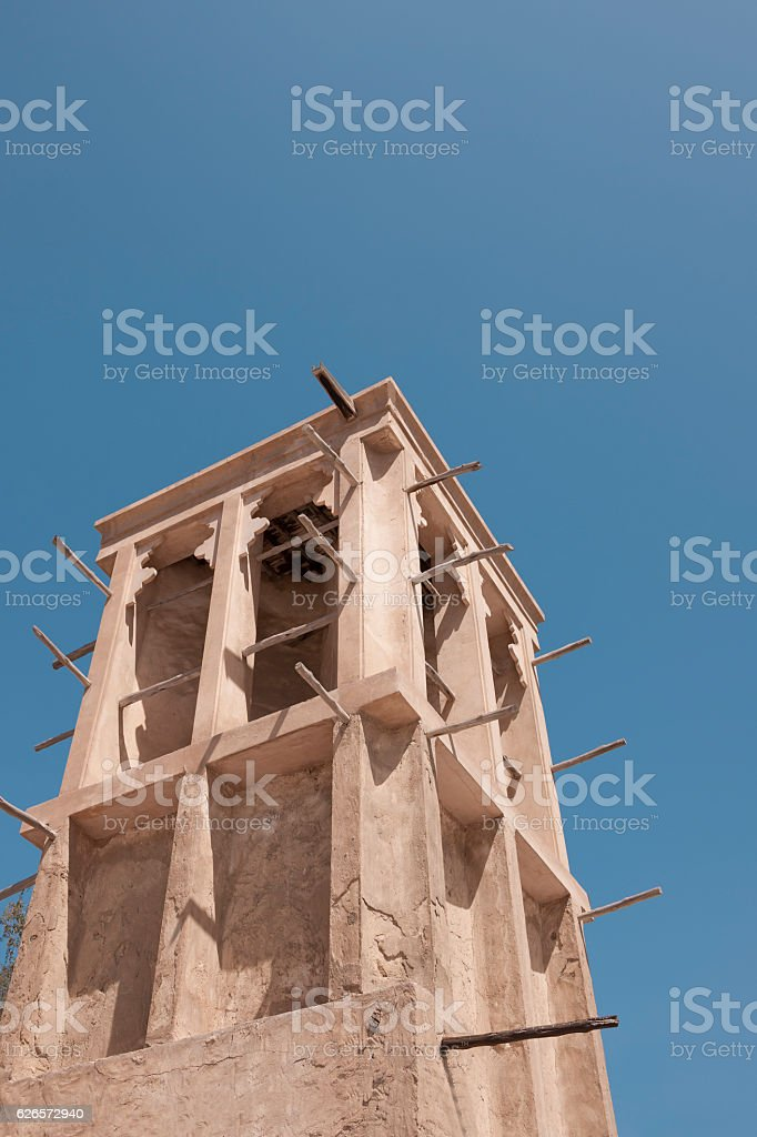 Old traditional wind tower of residential house in Bastakiya, Dubai stock photo