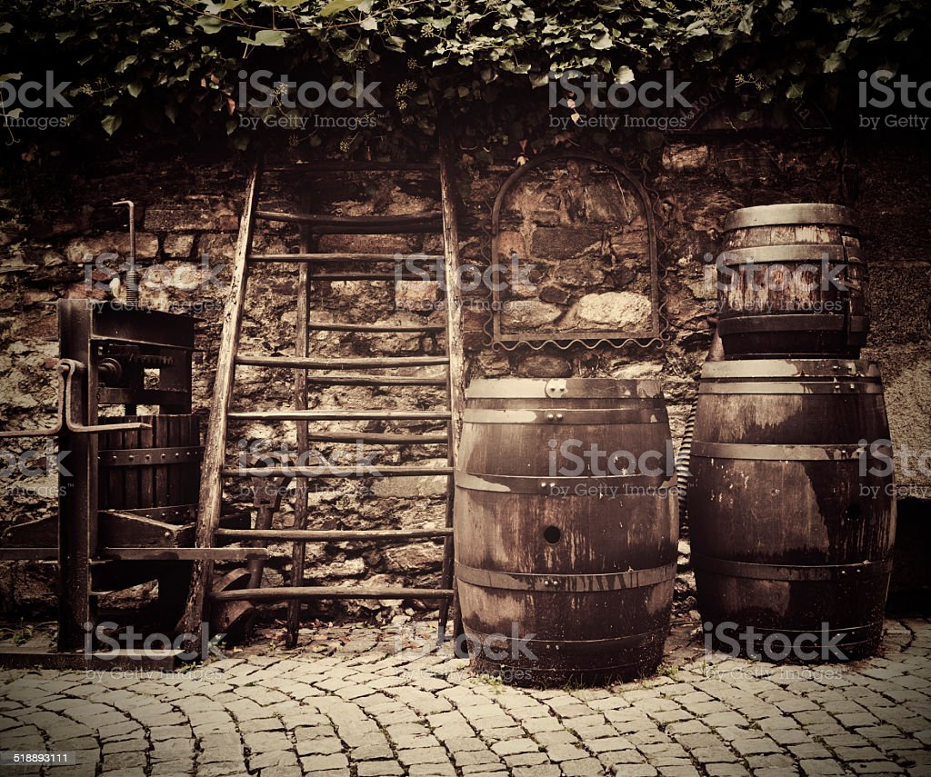 Old traditional wine press and oak barrels stock photo