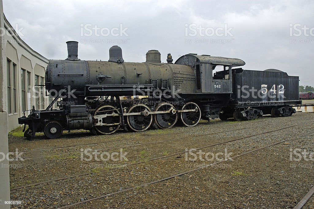 old train engine at a roundhouse royalty-free stock photo