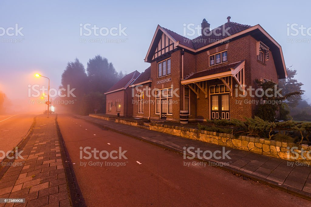 Old train station (1915-1972) at daybreak in the morning fog. stock photo