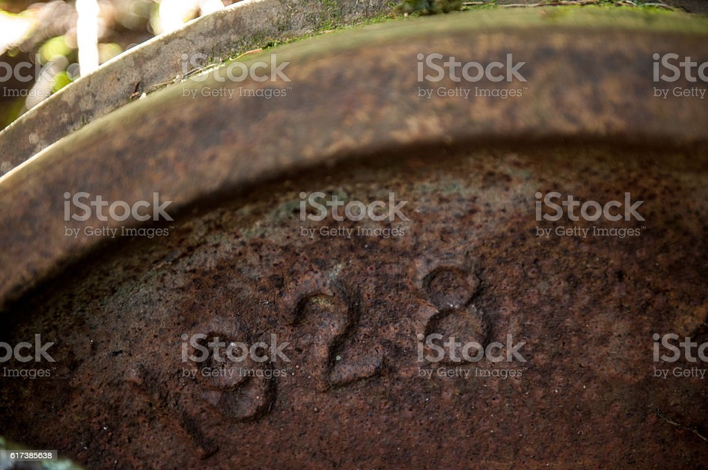 Old train wheel with the date 1928 stock photo