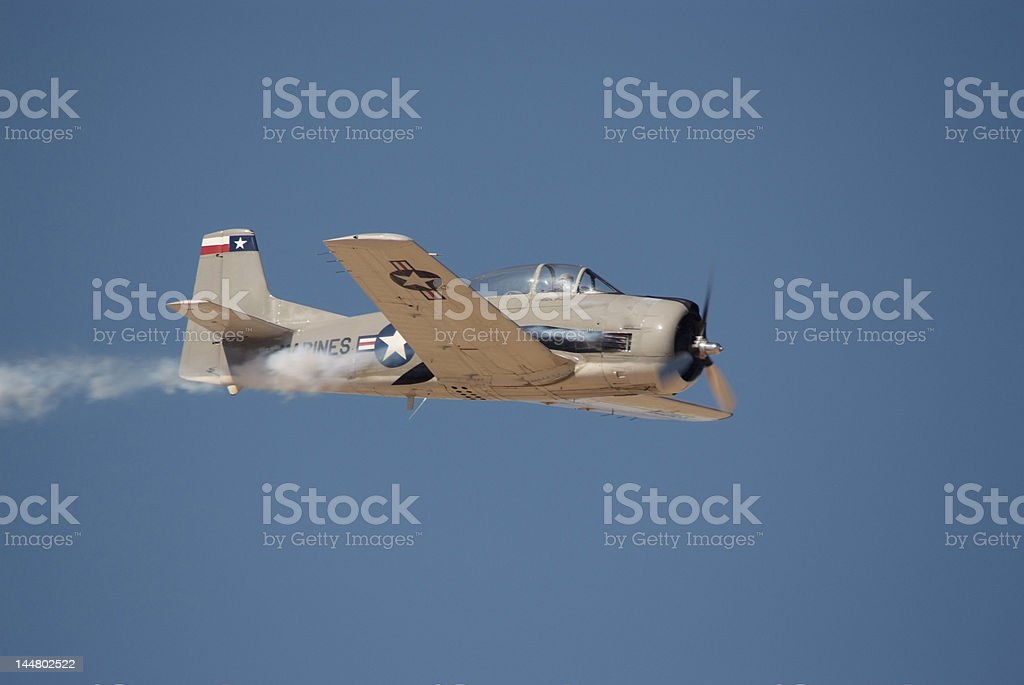 Old trainings air plane in the sky royalty-free stock photo