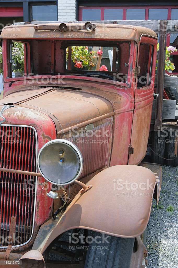 Old Truck and Flowers Decoration, 1930's Red Flatbed Close Up royalty-free stock photo
