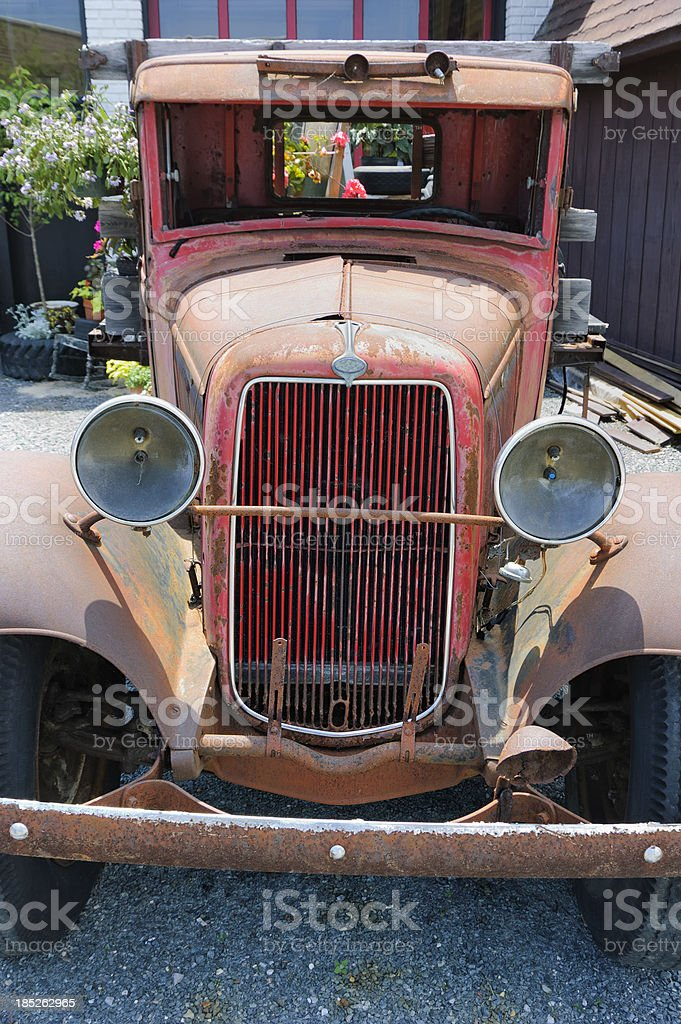 Old Truck and Flowers Decoration, 1930's Red Flatbed Pickup royalty-free stock photo
