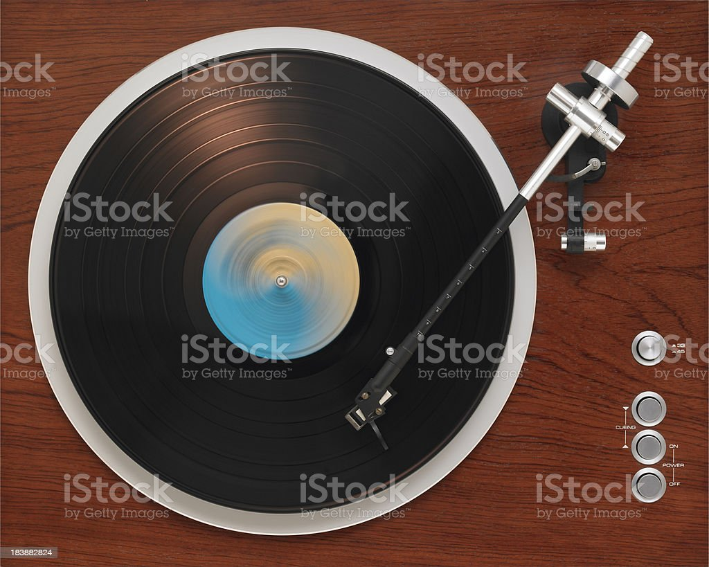 Old turntable playing record stock photo