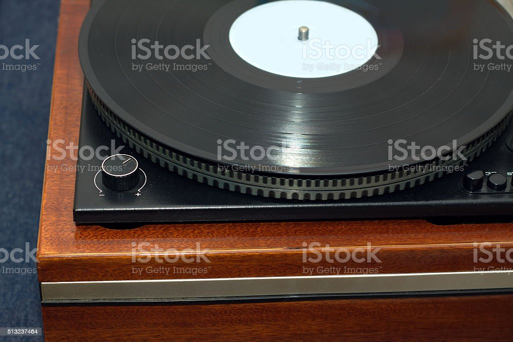 Old turntable with wooden finish top view isolated stock photo
