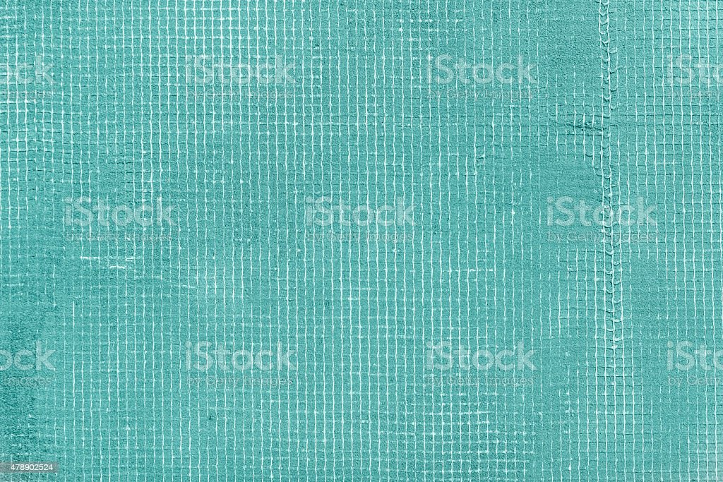 Old turquoise cement wall with net and stains, texture background stock photo