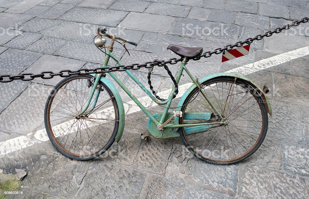 Old turquoise women's bike in Florence, Tuscany Italy stock photo