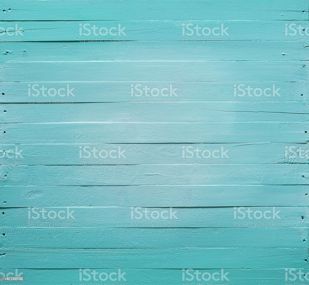 Old turquoise wooden panel background. stock photo