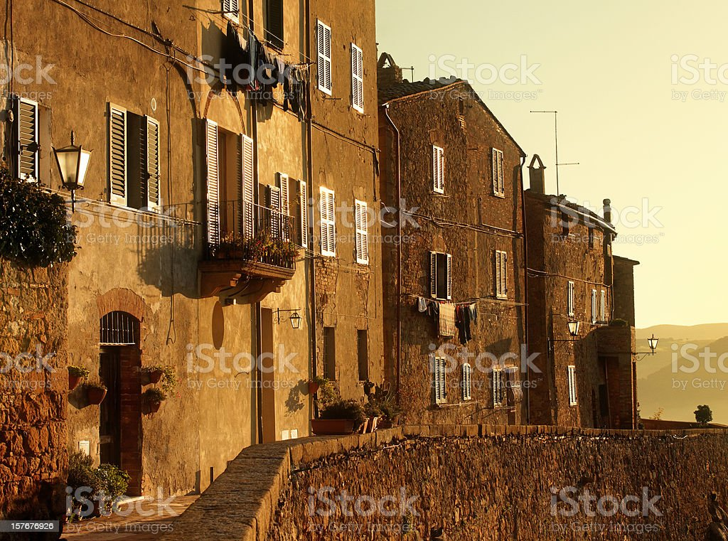 Old tuscan town in the morning sunshine stock photo