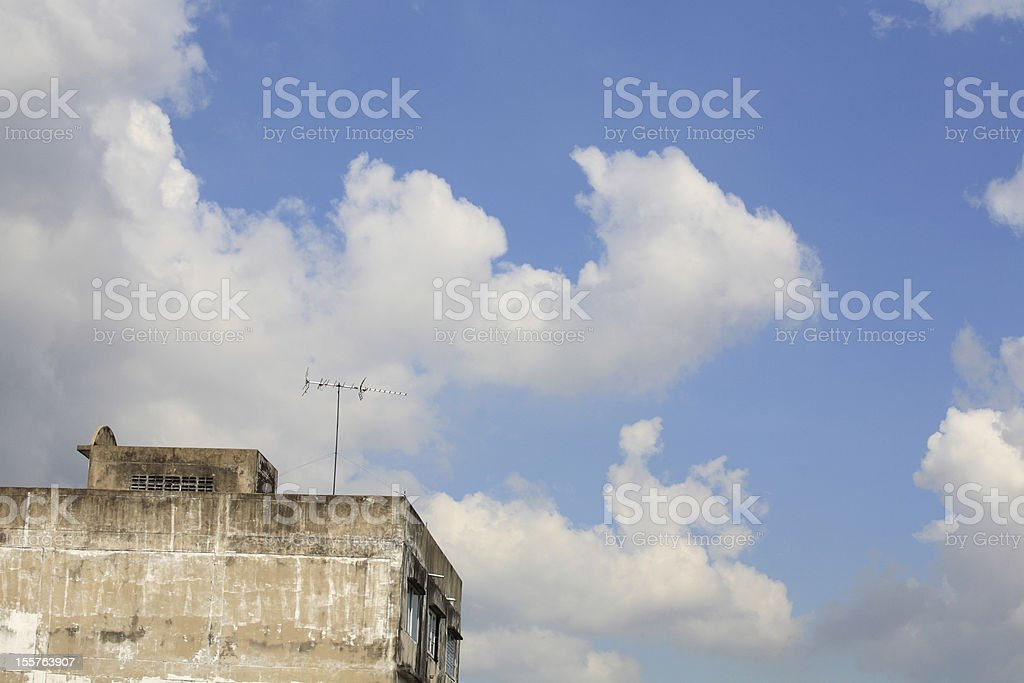 Old TV antenna on the building royalty-free stock photo