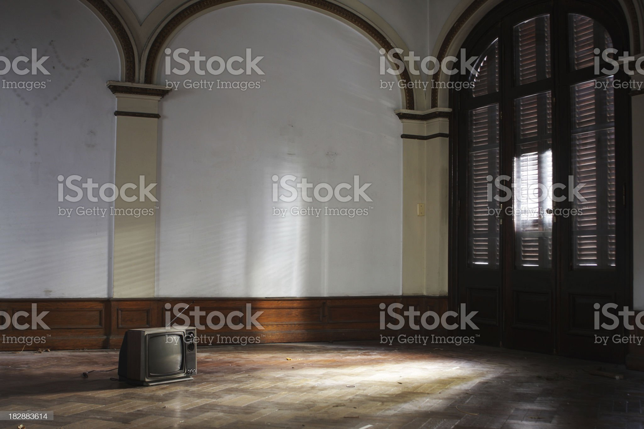 Old TV inside an abandoned house royalty-free stock photo