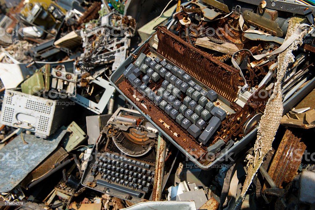 Old type writer on a scrapyard all rusted, junkyard