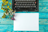 Old typewriter and a blank sheet of paper