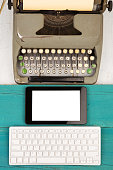 old typewriter and new computer keyboard, tablet pc