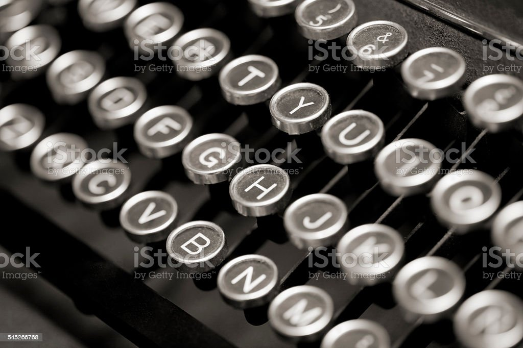 Old Typewriter Keyboard side view from above. stock photo