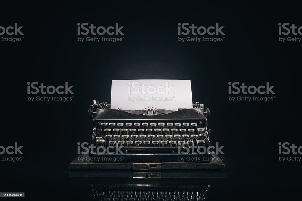 Old typewriter on a dark background stock photo