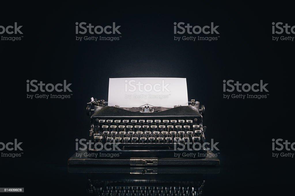 Old typewriter on a dark background stock photo