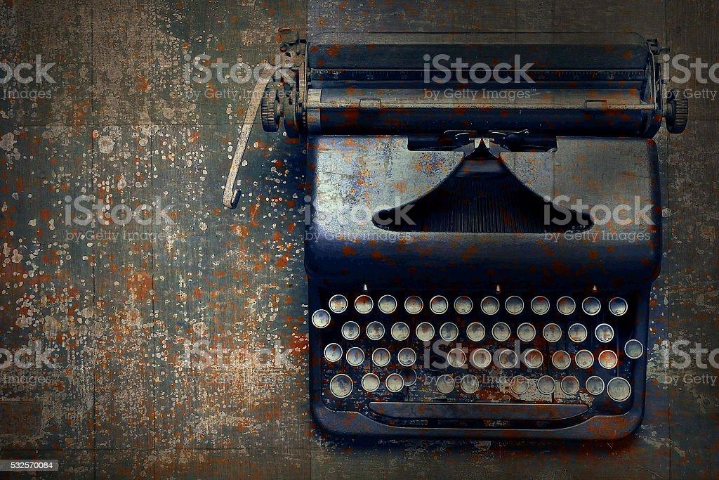 Old typewriter on the floor stock photo