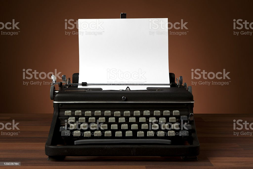 old typewriter with blank paper stock photo