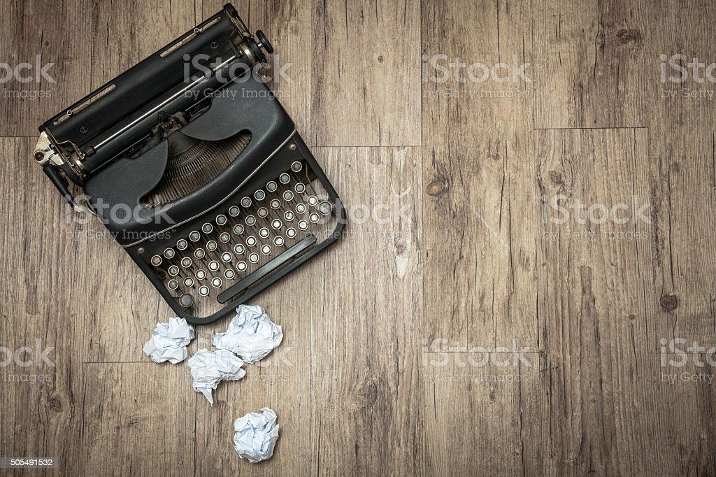 Old typewriter with paper ball stock photo