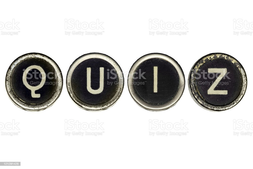 Old typewriter's keys spelling quiz stock photo