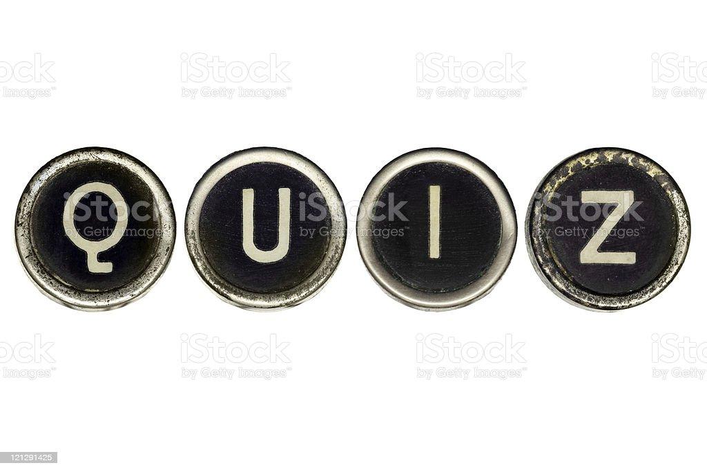 Old typewriter's keys spelling quiz stock photo