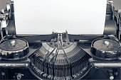 Old typing machine and blank sheet of paper for text