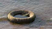 old tyre in the water