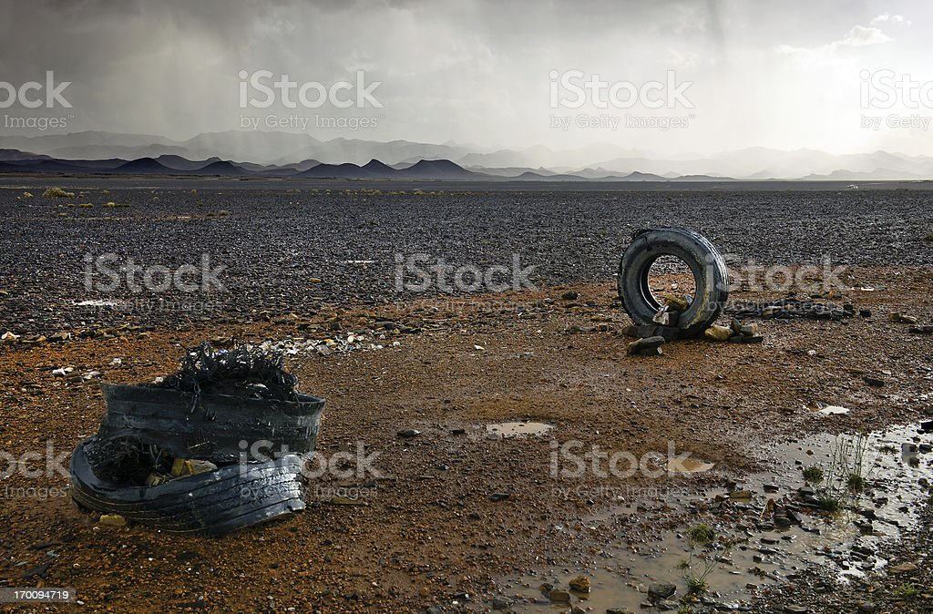 Old Tyres in Moroccan Desert Storm Behind royalty-free stock photo