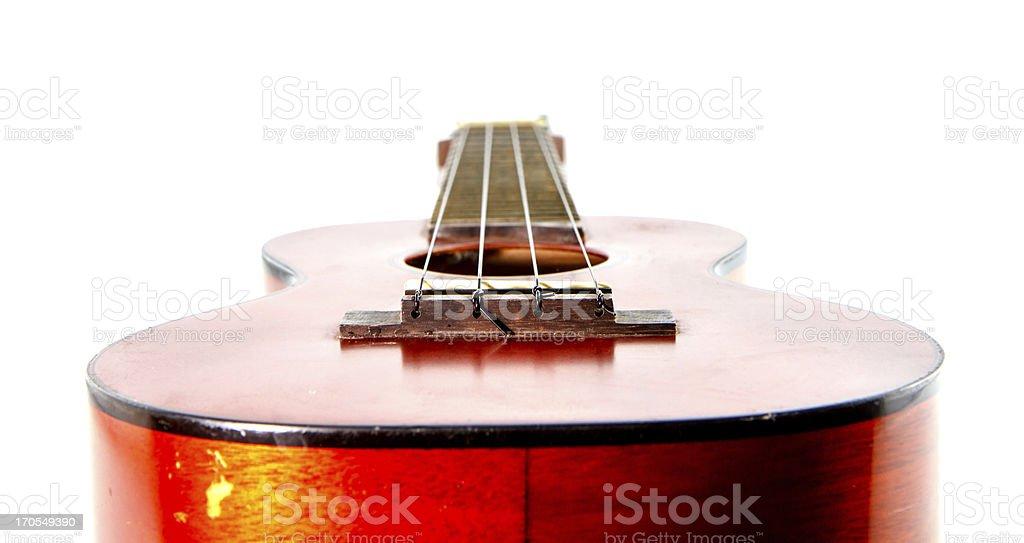 Old ukulele  on white background royalty-free stock photo