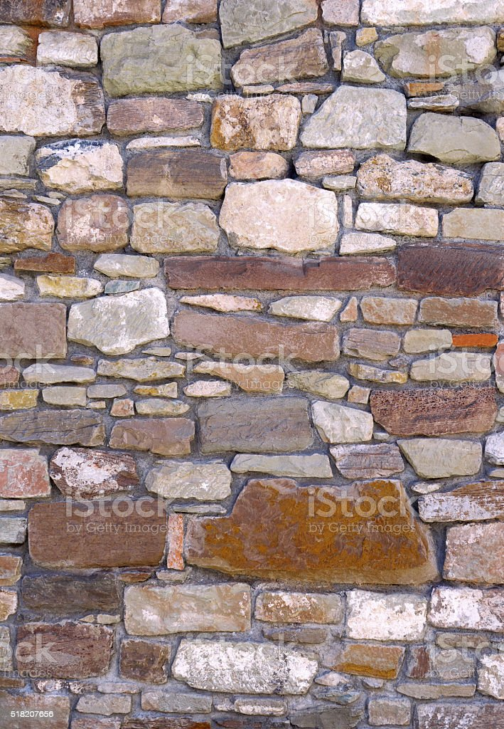 Old uneven stone wall stock photo