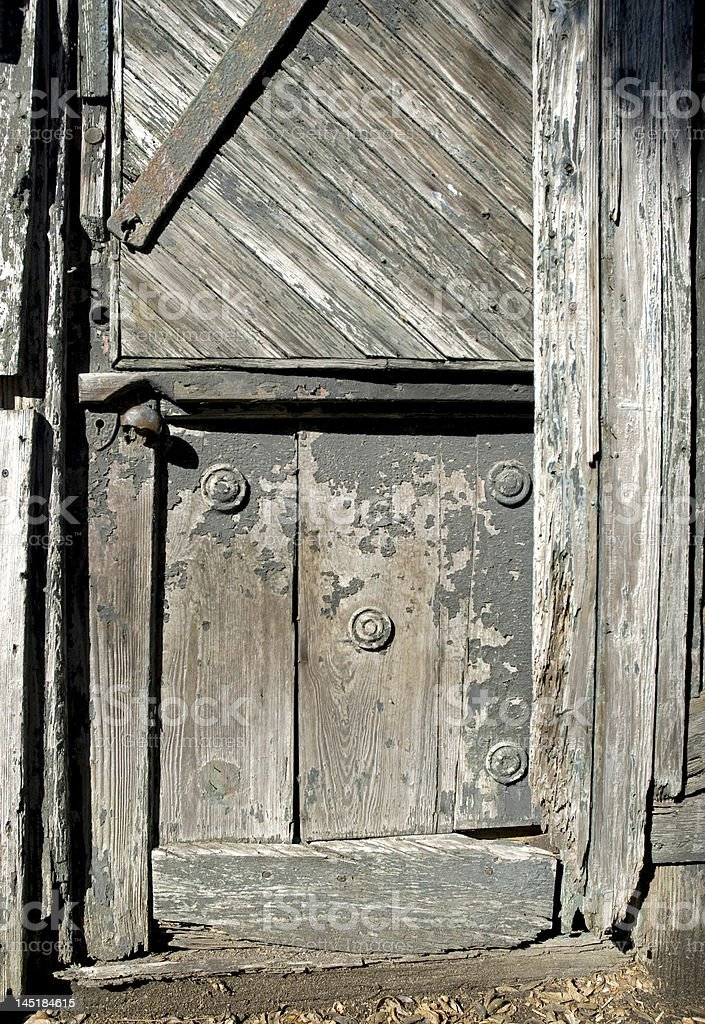 Old Unique Wooden Weathered Door royalty-free stock photo