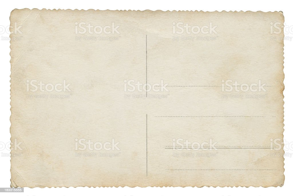 A old unmarked postcard sits on a white background royalty-free stock photo