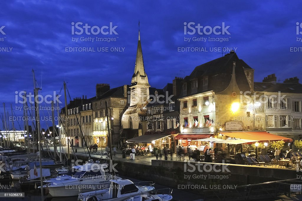 old urban port at night in Honfleur town, France stock photo